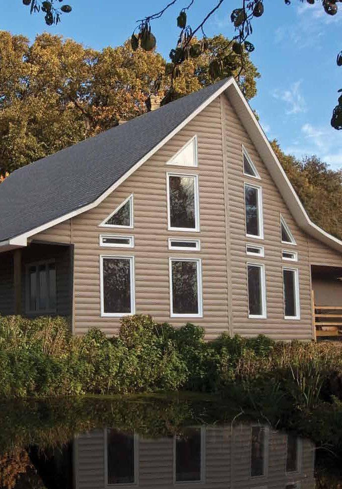 Montebello Vinyl Log Siding KayCan House by Pond